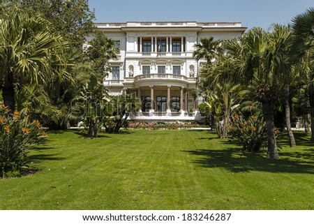 NICE, FRANCE - MAY 26, 2012: The Massena Palace Museum of Art and History, one of the main sights along Promenade des Anglais, built between 1898 and 1901 by the design of Hans-Georg Tersling