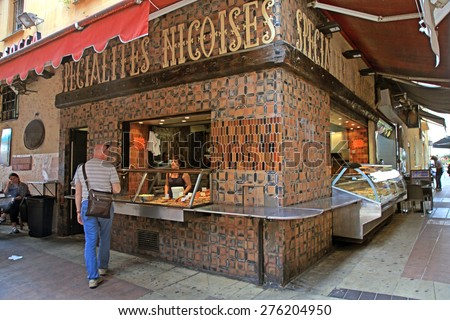 NICE, FRANCE - MAY 14, 2013: Unidentified people buying at Delicatessen stand at street food outdoor cafe in the Old town, Nice, French Riviera, Cote d'Azur, France. - stock photo