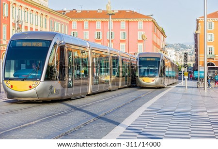 NICE, FRANCE - NOVEMBER 5, 2014: Modern tram in the centre of city. Tram is the main mode of transport in the city. The tram line connects the western and eastern parts of the city. - stock photo