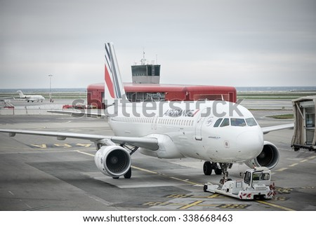 NICE,FRANCE - OCTOBER 27 2015 : french company air france airbus a320  pushed back from his airport gate by a special tractor.