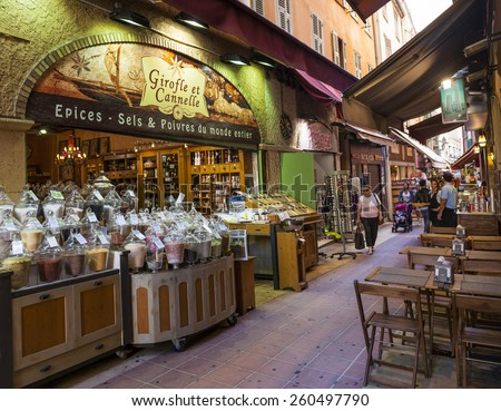 """NICE, FRANCE - OCTOBER 2, 2014: Gourmet food shop """"Girofle et Cannelle"""" on Rue Pairoliere, a quaint pedestrian shopping street in old Nice. - stock photo"""
