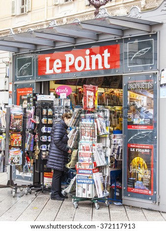 NICE, FRANCE - on JANUARY 11, 2016. A newsstand on the city street