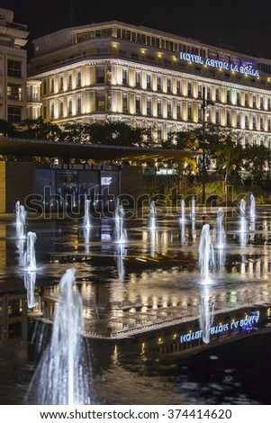 NICE, FRANCE - on JANUARY 8, 2016. A night view of an architectural complex of Promenade du Paillon and its reflection in water of the flat fountain