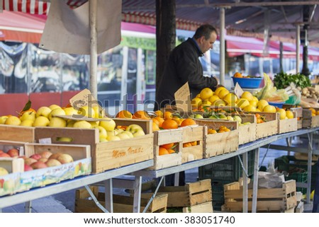 NICE, FRANCE, on JANUARY 13, 2016. Market counter, vegetables and fruit