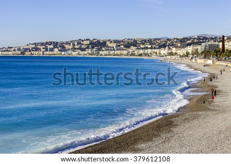NICE, FRANCE - on JANUARY 13, 2016. People have a rest on the city beach in the winter sunny day