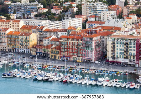 NICE, FRANCE, on JANUARY 7, 2016. The yachts moored in city port and buildings on the embankment. View from Shatto's hill