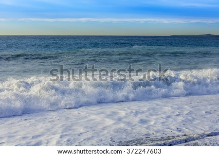NICE, FRANCE - on JANUARY 8, 2016. View of the line of a surf, wave, beach and sky