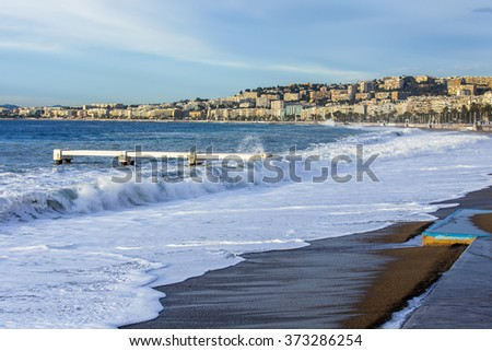 NICE, FRANCE - on JANUARY 8, 2016. View of the line of a surf, wave, beach and sky and embankment in a distance