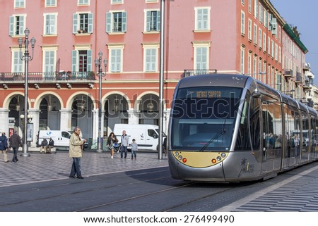 Nice, France, on March 11, 2015. The high-speed tram goes on Massena Square in the morning