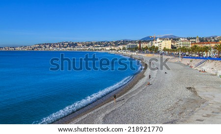 Nice, France, on October 16, 2012. View of the English promenade (Promenade des Anglais) and beach. Promenade des Anglais in Nice - one of the most beautiful and known embankments in Europe