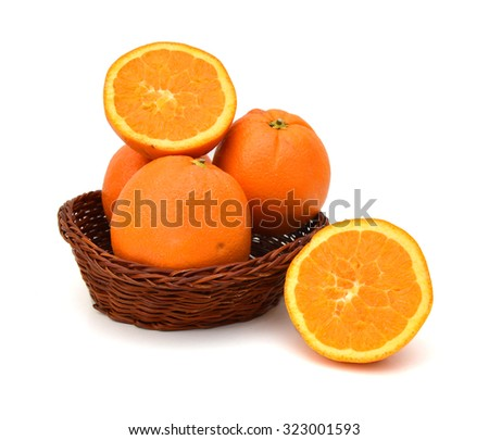 nice fresh orange isolated in basket on a white background