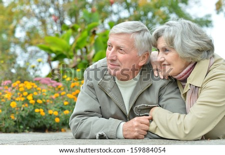nice friendly couple relaxing in the park in October - stock photo