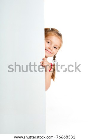 nice girl beside a white blank for text or image - stock photo