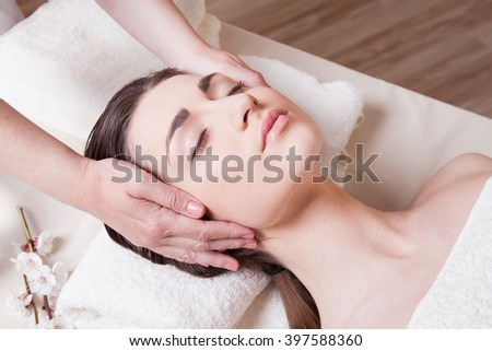 nice girl doing massage in the Spa - stock photo