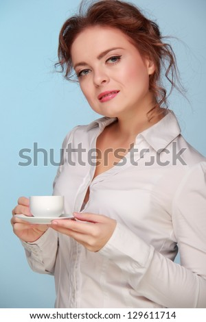Nice girl drinking coffee from a white cup/Fashion lovely business woman drinking coffee