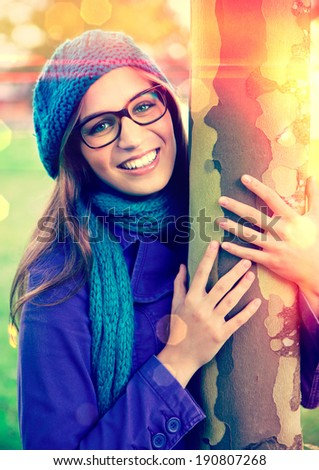 nice girl hugging a tree - stock photo