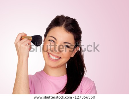 Nice girl make-up isolated on pink background - stock photo