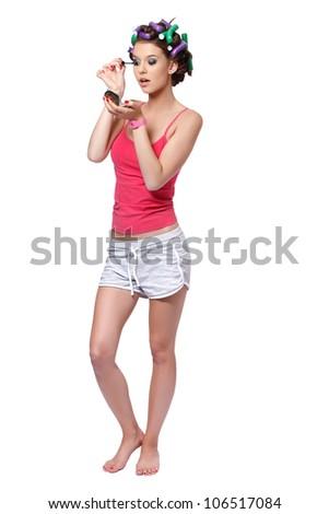 nice girl painting her eyelashes - stock photo
