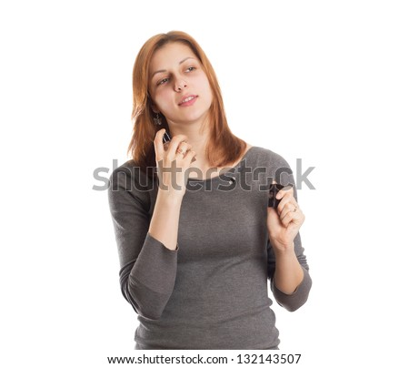 nice girl squirting perfume on her neck on a white background isolated