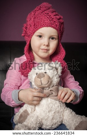 nice girl with a soft toy  - stock photo