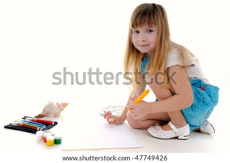 Nice girl with blonde long hair is painting on white background