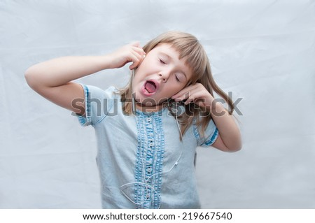 nice girl with earphones sings - stock photo