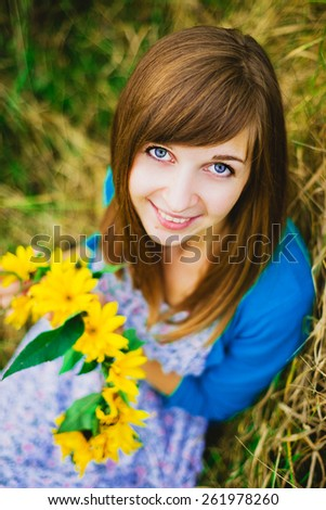 nice girl with yellow wreath on her hands - stock photo