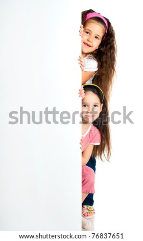 nice girls beside a white blank for text or image - stock photo