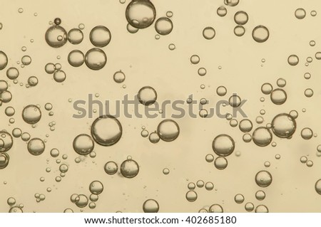 Nice golden champagne fizz bubbles in a crystal glass - stock photo