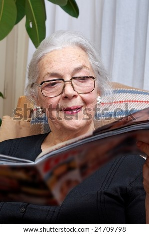 Nice grandmother read magazine