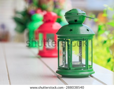 nice green lamp and colorful lamp in line on the white plank nature background - stock photo