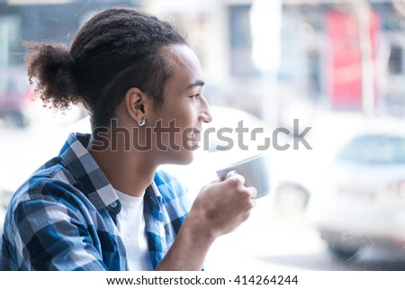 Nice guy sitting in the cafe - stock photo