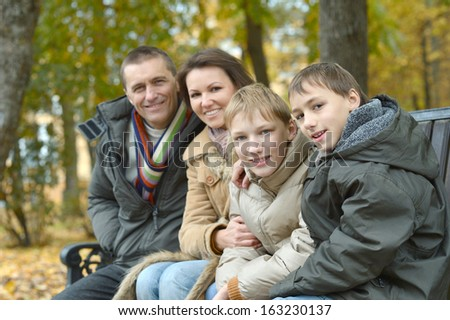 nice happy family for a walk in the park fall