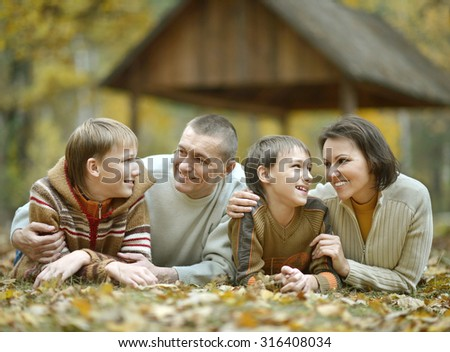 Nice happy family relax in the autumn park