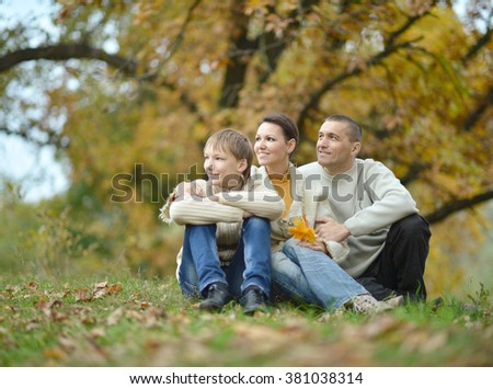 Nice happy family relax in the autumn park - stock photo