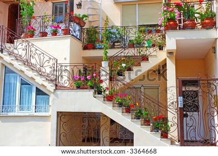 Nice house decorated with lots of colorful flowers - stock photo