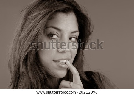 Nice Image of a Brunette woman on Grey