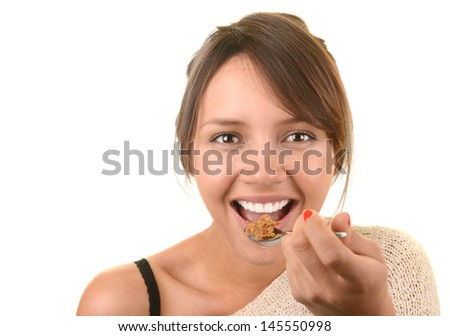 Nice image of a healthy Latino woman eating breakfast
