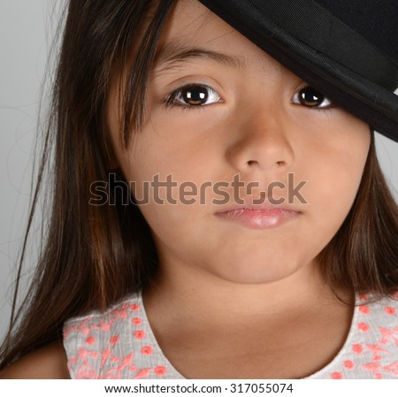 Nice Image of a young latino Actress with Bowler hat - stock photo