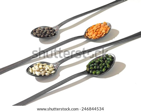 Nice image of cereals and legumes on long-handled teaspoons                                - stock photo