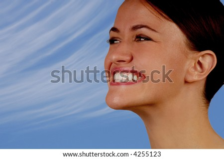 Nice image of woman smiling in the sunshine - stock photo