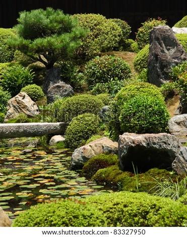 Nice Japanese Garden With A Stone Bridge