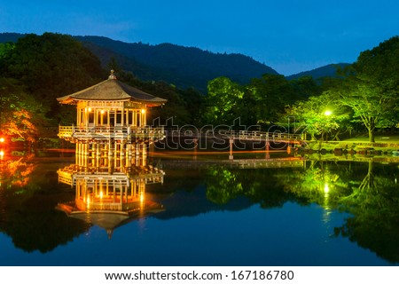 Nice japanese wooden gazebo is shortly after the sunset reflecting in the water. Nara, Japan. - stock photo