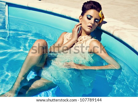 nice lady in the pool - stock photo