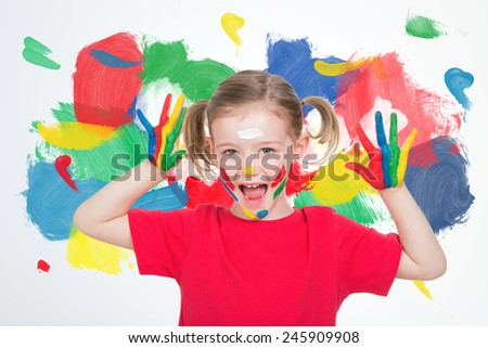 nice little blond child with paint face - stock photo