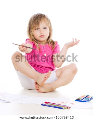 nice little girl surprised or trying to explain something and drawing with watercolor paint and brush isolated on white background