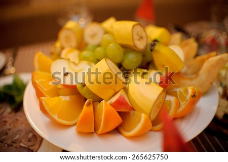 nice looking and tasty fruits on wedding reception - stock photo