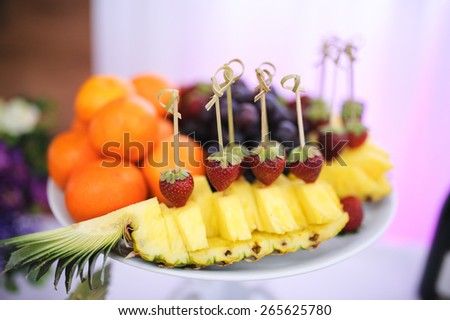 nice looking and tasty pineapple and strawberry on wedding reception - stock photo