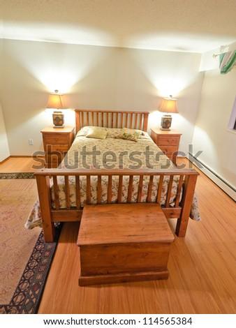 Nice looking cozy bedroom. Interior design. - stock photo