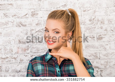 nice-looking girl in a checkered shirt asking to call her